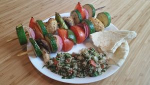 shish kebabs with tabouleh and pita bread